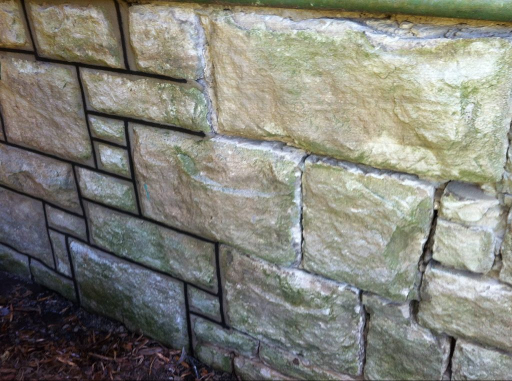 pointing a sandstone wall
