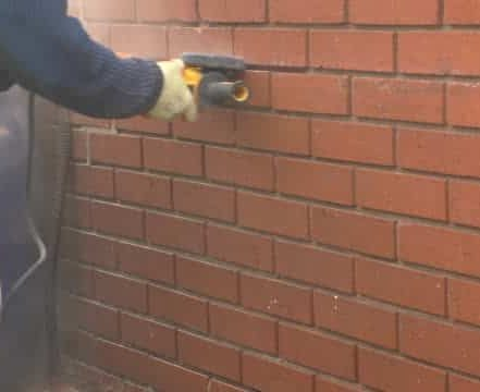 grinding out mortar before pointing